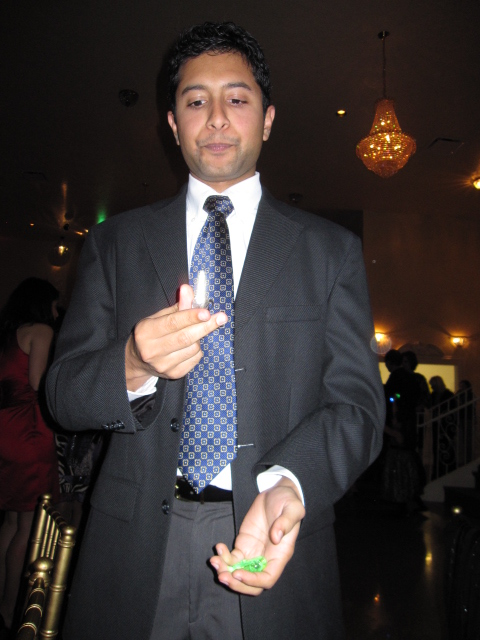Krishna juggling finger lights at Lindsey's wedding, 2011